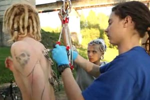 Dude jumps off bridge using body piercings as bungy cord