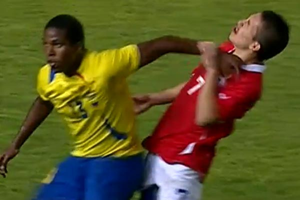Footballer punches himself with opponent's fist