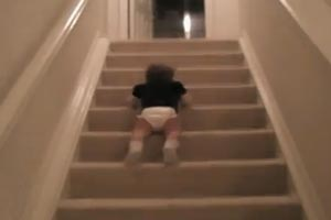 Baby slides down flight of stairs