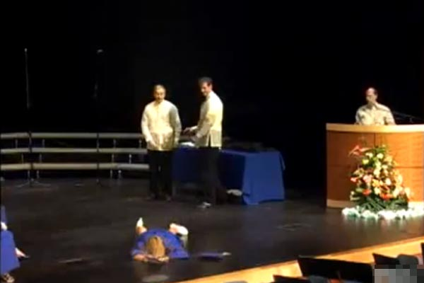 Chick's graduation faceplant