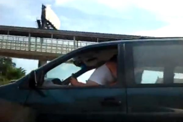 Couple caught on camera having sex while driving