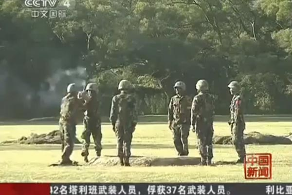 Chinese soliders pass around a live grenade