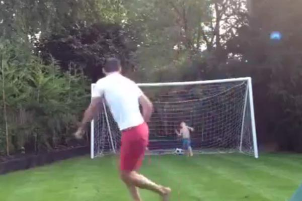 Dad owns kid with free kick
