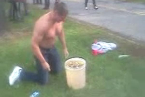 Man dunks head into piss bucket