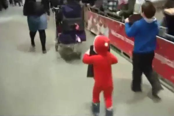 Excited xmas kid runs into trolley