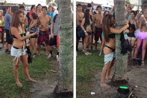Drunk or drugged up chick humps tree at festival