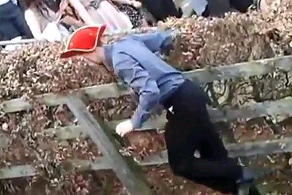 Drunk guy climbs a hill
