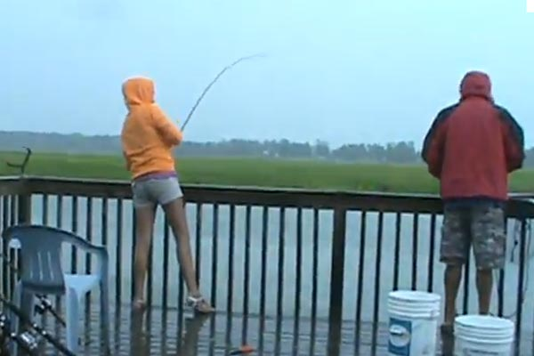 Girl gets a surprise while fishing