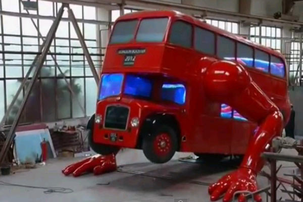 London double-decker bus does push ups for Olympics