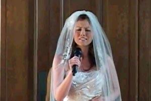 Bride sings walking down the aisle
