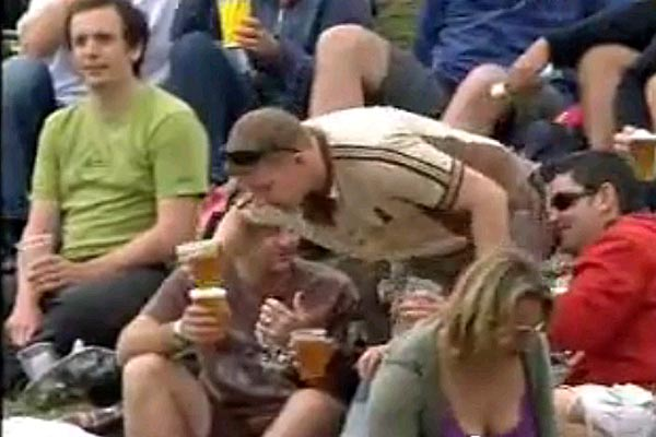 Kiwi cricket fan falls over with his pint