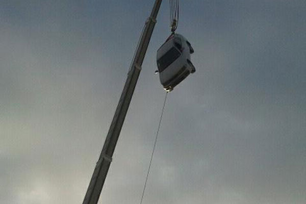 Roger's car hoisted 21m in the air