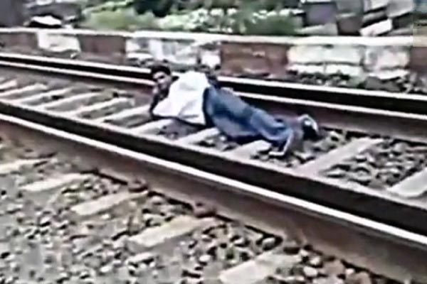 Man goes under a train