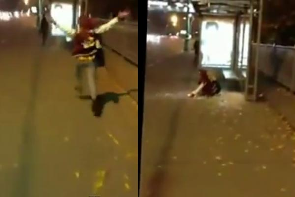 Drunk girl doesn't see bus stop glass