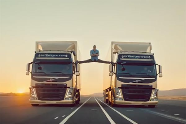 Van Damme doing the splits between two Volvo trucks