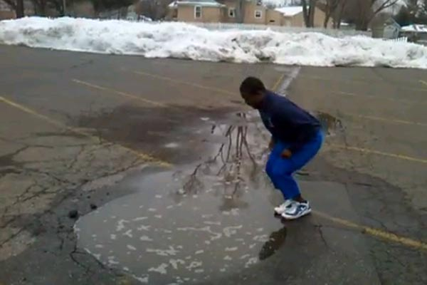 Man takes a dive into a puddle
