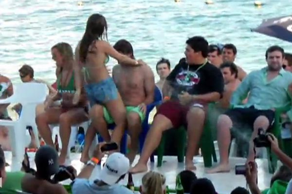 Drunk Spring Break bikini chick takes a tumble, falls off stage
