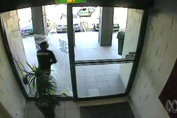 Robber crashes through glass window