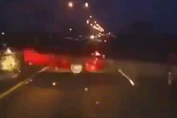 Dude ignores car crash, keeps on driving