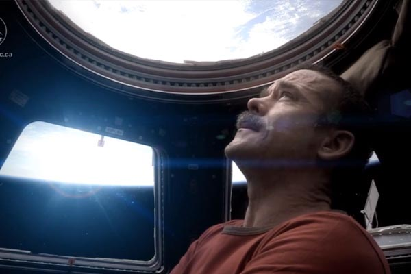 Astronaut pays tribute to David Bowie in space