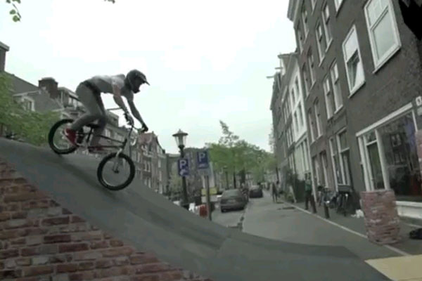 Biker backflips over a canal in Amsterdam