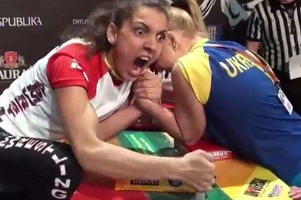 Arm wrestling screaming girl