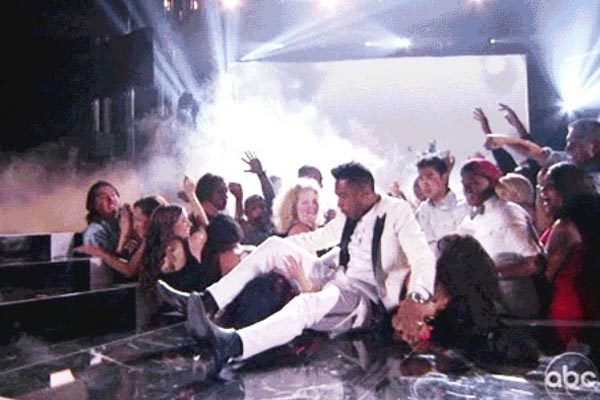 Miguel kicks two fans in the face
