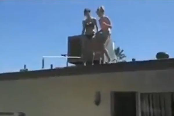 Two girls jump off a roof